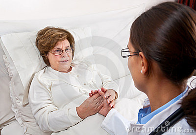 Doctor comforting senior patient
