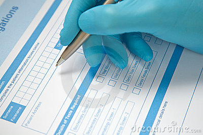 Doctor Completing Blood Test Form