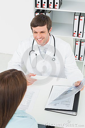 Doctor in conversation with female patient in medical office