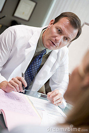 Doctor in discussion with patient in IVF clinic