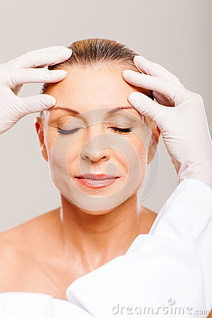 Senior woman skin check