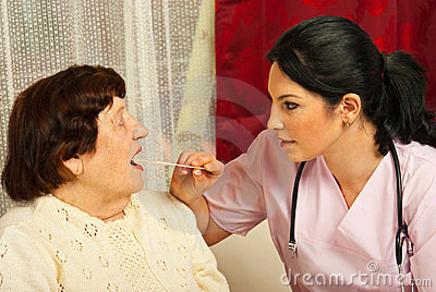 Doctor examine elderly for sore throat