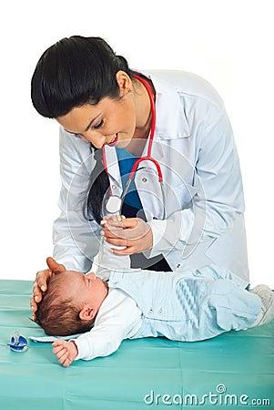 Doctor examine newborn baby