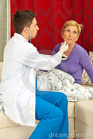 Doctor examine senior woman home