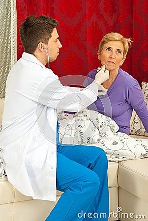 Doctor examine senior woman home