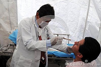 Doctor examines flu patient Editorial Image