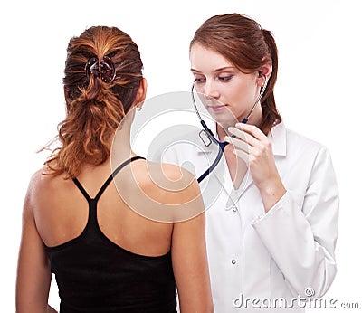 Doctor examines patient.
