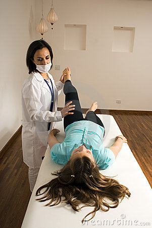 Doctor Examines a Patient s Leg-Vertical