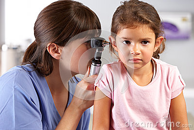 Doctor Examining Child s Ears In Doctor s Office