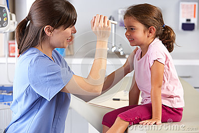 Doctor Examining Child s Eyes In Doctor s Office