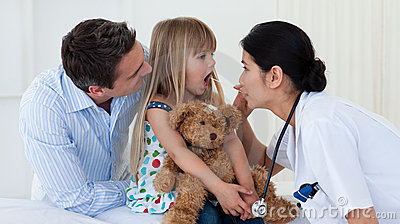 Doctor examining child s throat