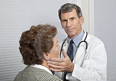 Doctor Examining Female Patient for Flu Symptoms