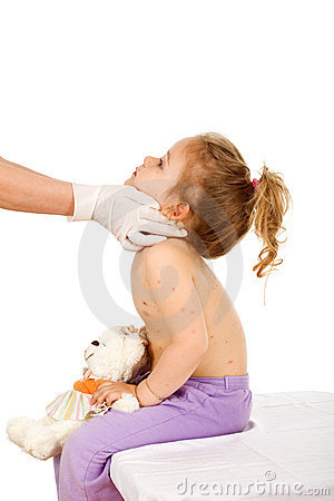 Doctor examining kid with small pox or skin rash
