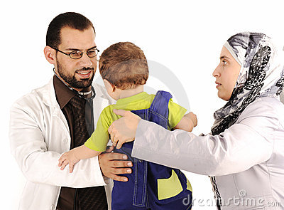 Doctor examining little baby