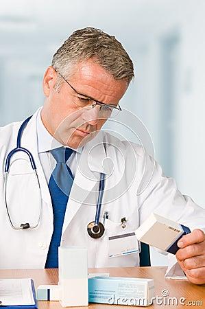 Doctor examining medicine cases