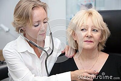 Doctor, examining patient