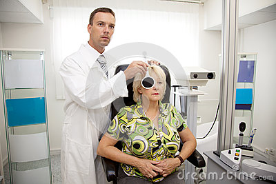 Doctor,examining a patient