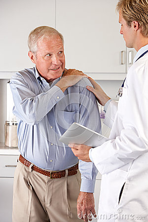 Doctor Examining Patient With Shoulder Pain