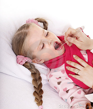 Doctor exams child with sore throat.