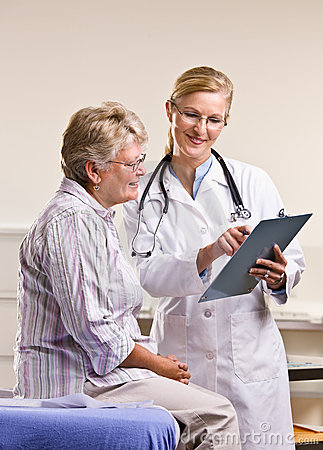 Doctor explaining medical chart to senior woman