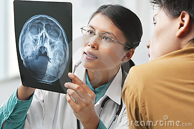 Doctor explaining skeleton xray to patient