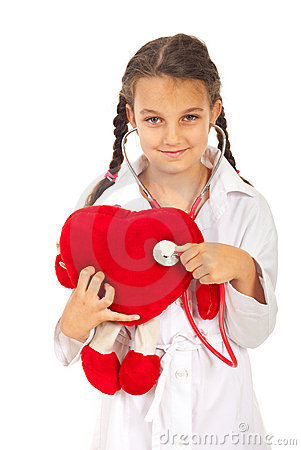 Doctor girl examine heart toy