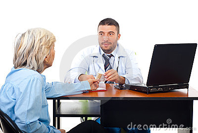 Doctor give ampules to senior woman