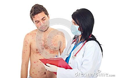 Doctor give prescription to sick man