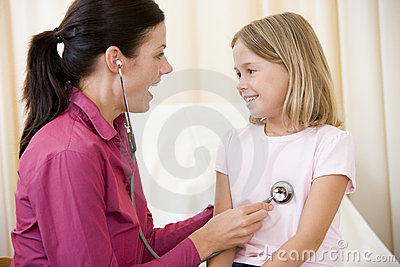 Doctor giving checkup with stethoscope