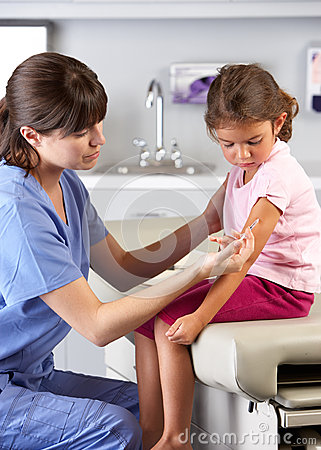 Doctor Giving Child Injection In Doctor s Office
