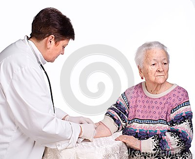 Doctor giving injection to old woman