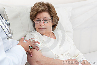 Doctor giving injection to Senior Patient