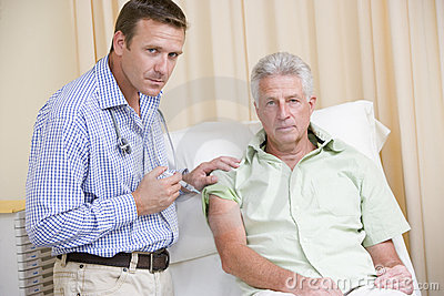 Doctor giving man needle in exam room