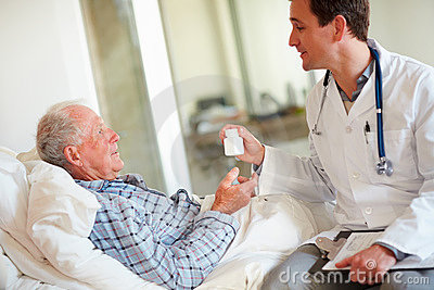 Doctor giving medicine to patient