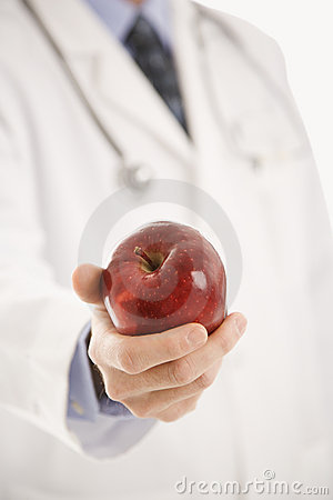 Free Doctor Holding Apple. Royalty Free Stock Photo - 2425995