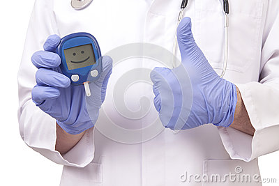Doctor holding blood sugar meter. Showing OK sign