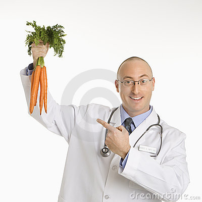 Free Doctor Holding Carrots. Royalty Free Stock Photography - 2425997