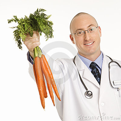 Free Doctor Holding Carrots. Stock Photo - 2431970