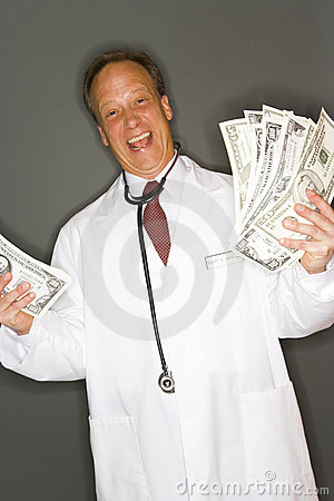 Doctor holding cash