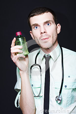 Doctor Holding Cold And Flu Cough Medicine