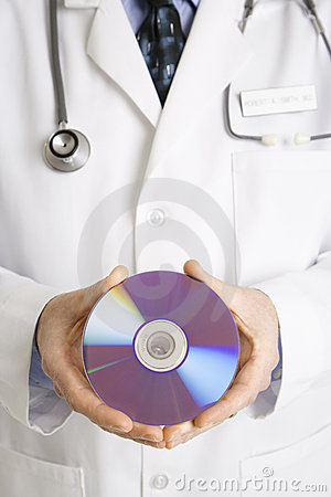 Doctor holding compact disc.