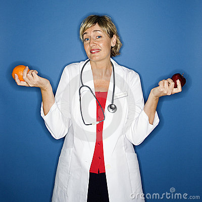 Doctor holding fruit.