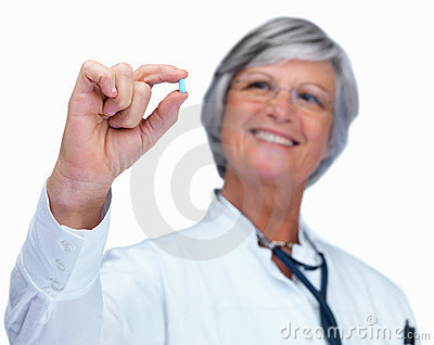Doctor holding out a medicine tablet