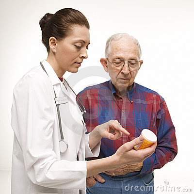 Free Doctor Holding Prescription Stock Photo - 2051970