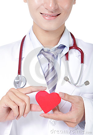 Doctor holding a red love heart pillow
