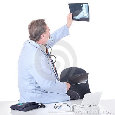 Doctor holding X-ray slide up