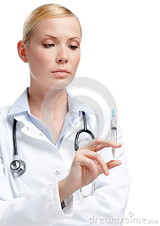 Doctor holds a syringe