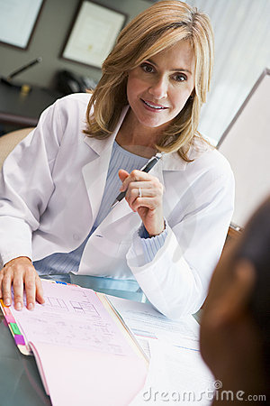 Free Doctor In Discussion With Patient In IVF Clinic Stock Images - 5004714