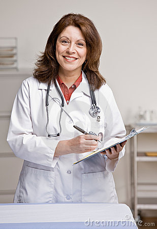 Doctor in lab coat holding medical chart