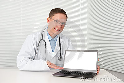 Doctor in lab coat with laptop